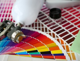 A paint sprayer with color sheets around it