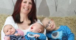 Triplets born nearly three years apart