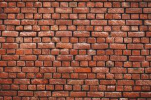 wall constructed of orange bricks