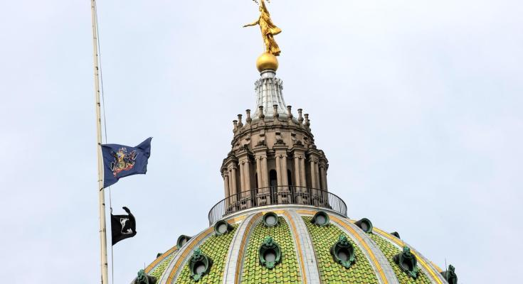 United States and Commonwealth Flags at Half-Staff