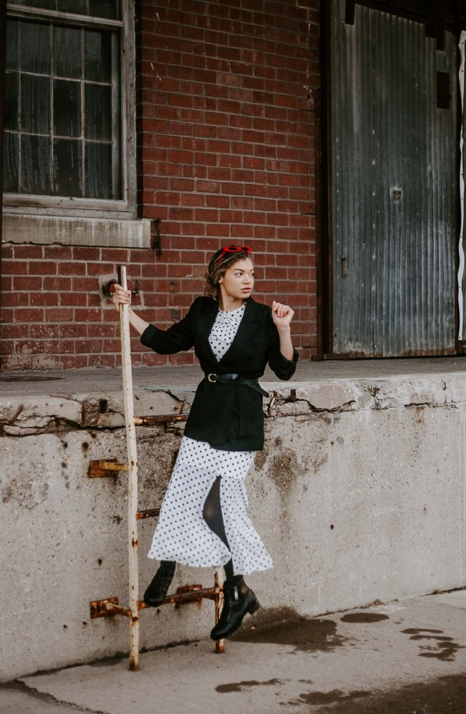 polka dot dress with moto boots and a blazer for an outfit inspired by french fashion