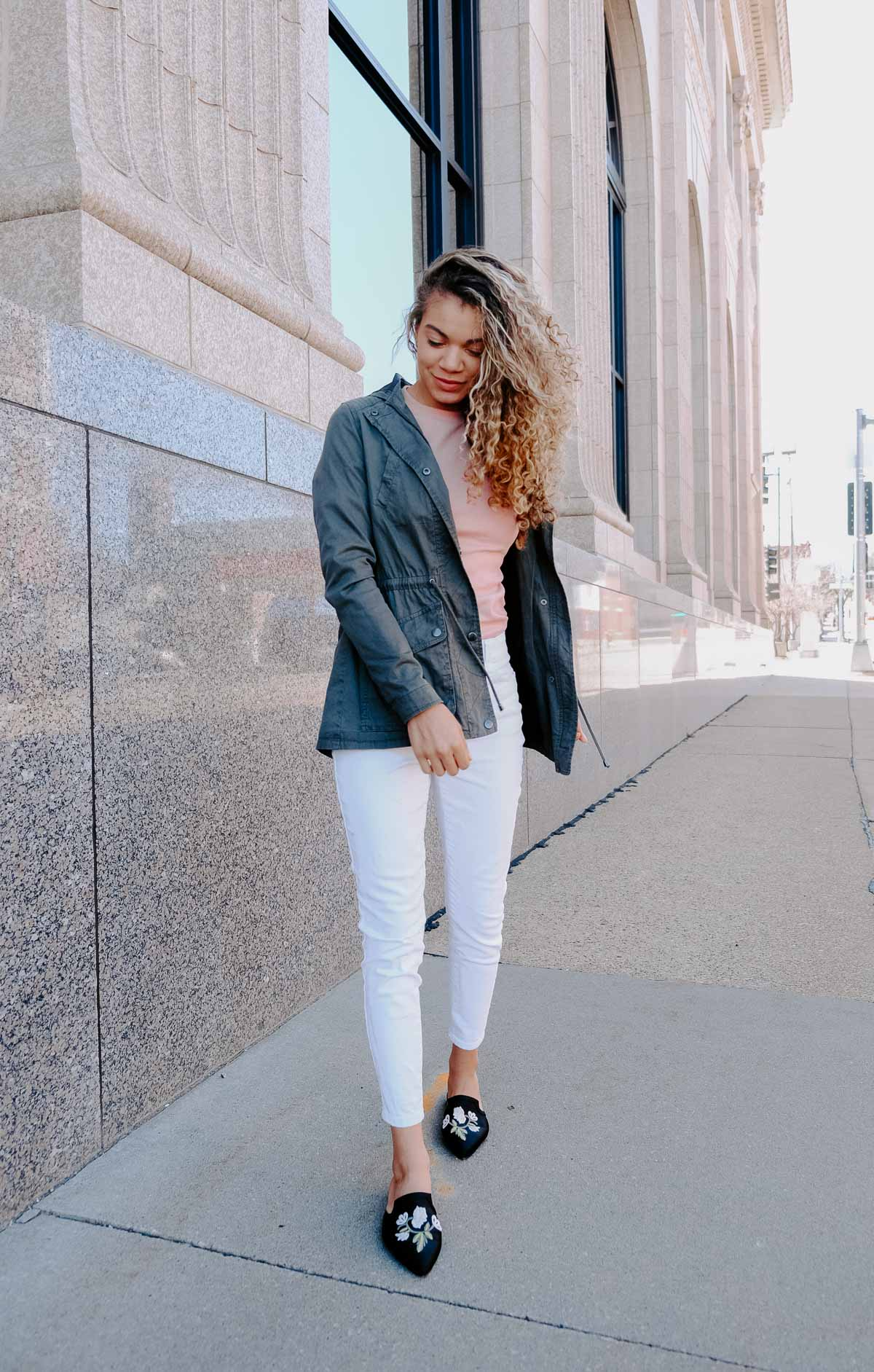 white jeans with a pink top and a utility jacket makes the perfect spring and summer outfit!