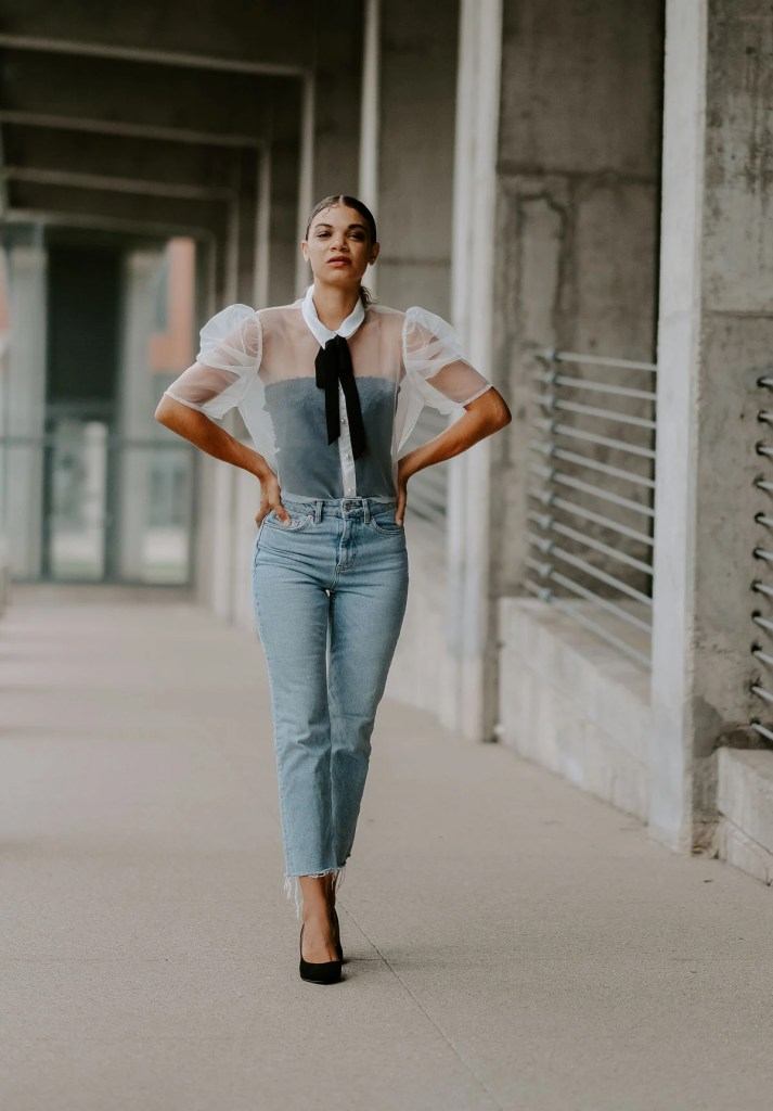 chic outfit and slicked back ponytail