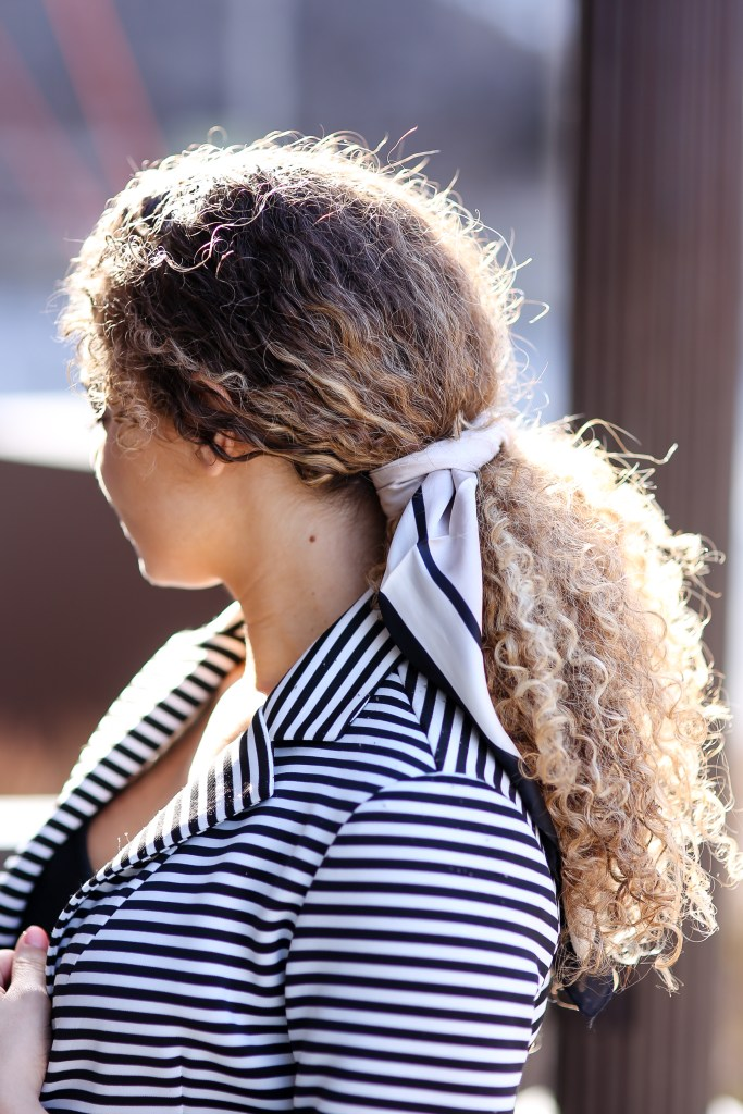 how to look stylish using a silk scarf tied in hair