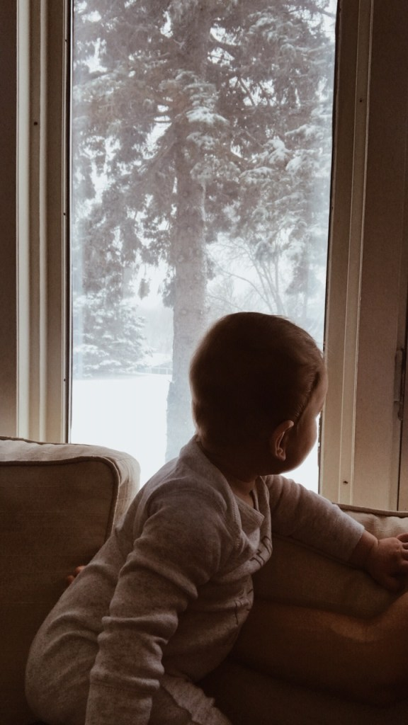 baby looking out the window
