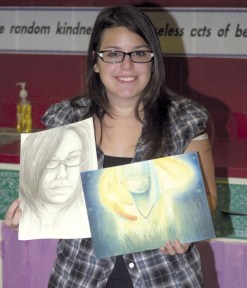 Naugatuck High School student Amanda Guglielmo shows off some of the work that makes her a standout in AP art classes.