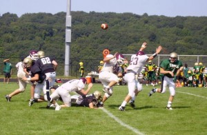 Woodland quarterback Steve Petracca tosses a touchdown pass to Colin Grommisch against North Haven.
