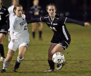 Woodland's Katie Reilly and Naugatuck's Sarah Magnamo compete for a loose ball during the Hounds' 2-0 win Monday night.