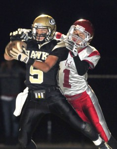 Brandon Fowler picks off a pass in the end zone, intended for Naugy's Tyler Conklin, during the Hawks' 28-21 win Friday.