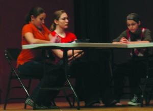 "Juror 8 (Stefanie Cagno, far left) was the lone vote of ""not guilty"" early on in last weekend's production. By the play's end, she had convinced the rest of the jury that there was, indeed, cause for reasonable doubt."