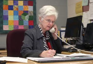 Woodland Regional High School's Assistant Principal Maureen Carroll talks on the phone in her office Friday. Carroll started out as a history teacher at the school when it opened in 2001 and later moved to her current position which she is now preparing to retire from.