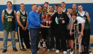 Team sponsor Kevin McSherry (left) holds the NBA championshp trophy with head coach Bill Cowan, as the rest of squad poses for a team photo. The players are, in no particular order: Jake Bendler, Jake Mulhall, Brandon Halbert,Dave Kimball, Sean Brelsford, Evan Dwyer, Seth Mulhall, Zack Williams, Billy Tiscia, R.J.Hanson, Conner Mohan and Rob Antidormi.