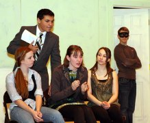 """From left, Sophomore Stephanie Hensley, playing Kate, freshman Preston Bogan, playing Dr. Wells, junior Erica Blasko playing Juliet, junior Danielle Wicks, playing Cordelia, and senior Jeff O'Brien, playing the mysterious man, rehearse a scene for the drama club play """"Ladies Sigh no More."""""""