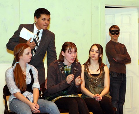 "From left, Sophomore Stephanie Hensley, playing Kate, freshman Preston Bogan, playing Dr. Wells, junior Erica Blasko playing Juliet, junior Danielle Wicks, playing Cordelia, and senior Jeff O'Brien, playing the mysterious man, rehearse a scene for the drama club play ""Ladies Sigh no More."""