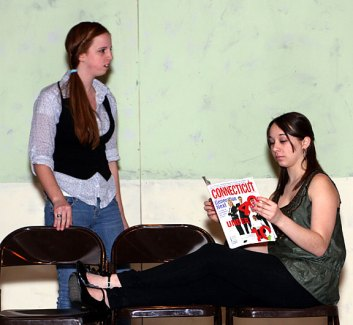 """Sophomore Stephanie Hensley, playing Kate, berates junior Danielle Wicks, playing Cordelia during rehearsal for the drama club play """"Ladies Sigh no More."""""""