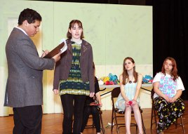 """Freshman Preston Bogan, left, playing Dr. Wells, rehearses a scene with Sophomore Chelsea Newman as Lady Ann for the high school production of """"Ladies Sigh no More."""""""