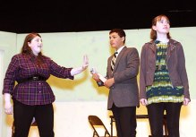 """From left, junior Melissa Campo, playing Lady Macbeth, Freshman Preston Bogan, playing Dr. Wells, and Sophomore Chelsea Newman, playing Lady Ann, rehearse a scene for the high school production of """"Ladies Sigh no More."""""""