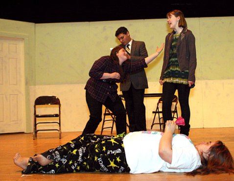 """Freshman Angela Buckley, front as Desdemona, and from left, junior Melissa Campo, playing Lady Macbeth, Freshman Preston Bogan, playing Dr. Wells, and Sophomore Chelsea Newman, playing Lady Ann, rehearse a scene for the high school production of """"Ladies Sigh no More."""""""
