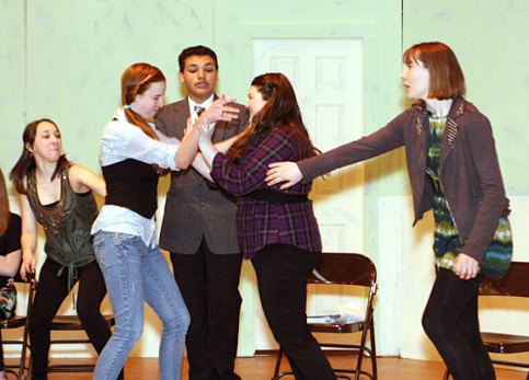 """From left, Sophomore Stephanie Hensley as Kate, freshman Preston Bogan, playing Dr. Wells, junior Melissa Campo, playing Lady Macbeth, and Sophomore Chelsea Newman, playing Lady Ann, rehearse a scene for the high school production of """"Ladies Sigh no More."""""""