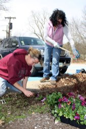 Naugatuck Historical Society President Wendy Murphy, left, and Sondra Harman of the Naugatuck River Revival Group, plant flowers donated by Flowers Plus outside the Historical Society Museum as part of Earth Day efforts April 22.