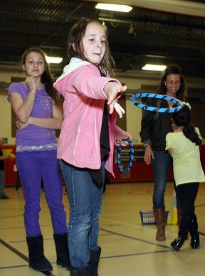 """Emily Dyer, 9, tries to """"Ring a Run"""" at Maple Hill math night."""