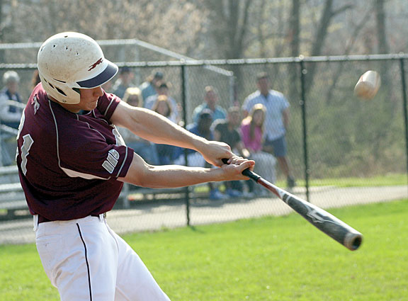 Naugatuck's Karl Johansen connects with a pitch Monday at Woodland. The Greyhounds held on to defeat the Hawks 4-2, after scoring all their runs in the first. -LARAINE WESCHLER