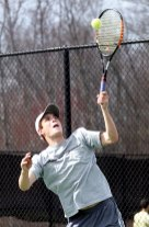 Naugy's No.1 seed, Richard Mitchell, serves it up Monday against Naugatuck. He was defeated by Woodland's Mike Krakowski, 8-2.