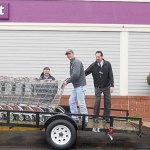 From left Gerhard Roland of the Ecumenical Food Bank, Steve Rimkus of Integrity Landscaping and John Tardette, manager at Stop & Shop load shopping carts on a trailer. Stop & Shop donated the carts to the food bank.