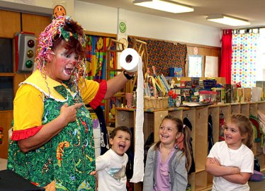 From left, Anthony Queiros, Layla Nemeth, and Aviana Ramos are delighted by Sparkles the Clown and her magic toilet paper during a performance at Tender Years Preschool May 13. Gigi Ramos, Aviana's grandmother, hired Sparkles to entertain the kids.