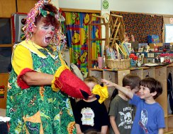 John DeBisschop holds up a missing scarf to Sparkles the Clown during a performance at Tender Years Preschool May 13. Gigi Ramos, grandmother of one of the other students in the class, hired Sparkles to entertain the kids.