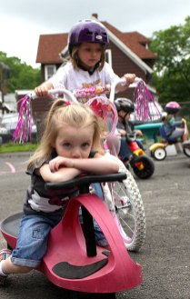 Alivia Stewart, front, and Hannah DeCampos trike in the parking lot of Tender Years Preschool in Naugatuck during the annual Trike-a-Thon May 20.