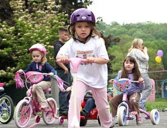 From left, Emma Rinaldi, Hannah DeCampos, and Maya Dias trike around the parking lot of Tender Years Preschool in Naugatuck during the annual Trike-a-Thon May 20.