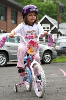 Hannah DeCampos peddles around the parking lot of Tender Years Preschool in Naugatuck during the annual Trike-a-Thon May 20.