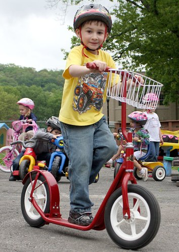 Joey Spina scoots around the parking lot of Tender Years Preschool in Naugatuck during the annual Trike-a-Thon May 20.