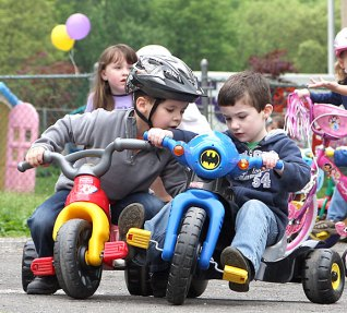 Matthew DosSantos, left, and James Korowotny confer in the parking lot of Tender Years Preschool in Naugatuck during the annual Trike-a-Thon May 20.