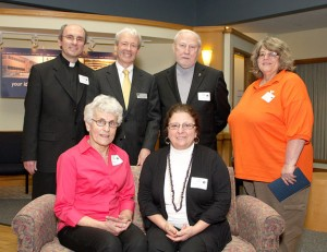 Back row, from left, Father Adam Hurbanczuk of St. Mary's and St. Hedwig churches, Mark Yanarella, president and CEO of Naugatuck Savings Bank, Deacon Earle Kimball of St. Mary's and St. Hedwig churches, and Michele McDougall of the Naugatuck YMCA and front row, from left, Jeanne Generali and Angela Leveille of the Middlebury Senior Center pose at the Naugatuck Savings Bank Awards reception May 11. The churches, YMCA, and senior center were top recipients of grant money offered by the bank.