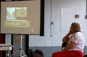 Beacon Falls First Selectman Susan Cable watches a presentation about Benedetti's asphalt recycling equipment during a presentation at the fire house Tuesday night.