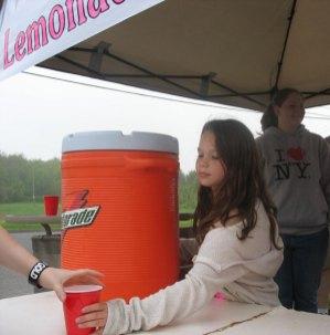 Karly Laliberte serves up a fresh glass of lemonade May 21.