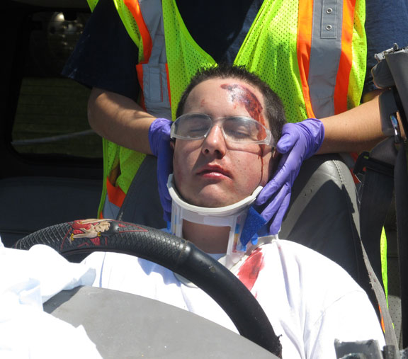 A victim is extricated from his car during a mock crash demonstration staged at Woodland Regional High School.