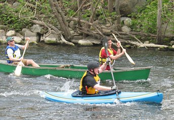 A canoe and a kayak go head to head during the 4th annual Naugatuck Valley River Race and Festival May 7. PHOTO BY ELIO GUGLIOTTI