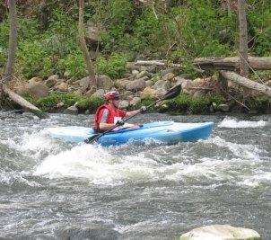 Jim Schumacher paddles down the river during the 4th annual Naugatuck Valley River Race and Festival May 7. PHOTO BY ELIO GUGLIOTTI
