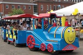 A train runs through the vendors at Naugatuck Duck Day June 5.