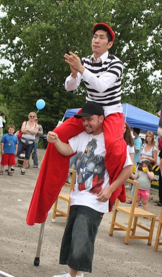 Rob Lok, top, with Cirque Du Jour, performs with the help of Dave Alvarez at Naugatuck Duck Day June 5.