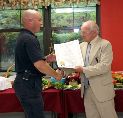 State Sen. Joe Crisco, right, recognized firefighter Stephen Sousa for his role in saving a Naugatuck resident's life.