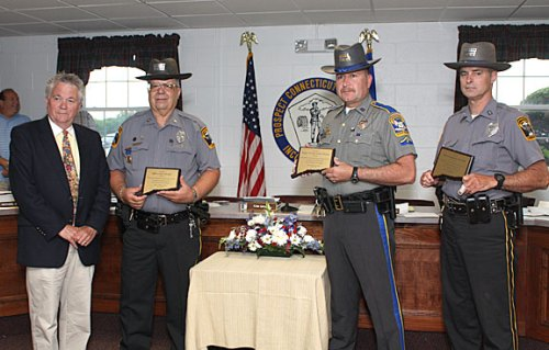 Prospect Mayor Robert Chatfield, left, honors Prospect Police officers, from left, Andy Giordino, Nelson Abarzua, and Douglas Fairchild for their role in capturing two bank robbers following a March 26 robbery of Wells Fargo Bank in Prospect.