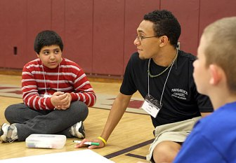 Anthony Rodrigues, left, discusses leadership with Fred Carter, right during a leadership conference at Naugatuck High School.