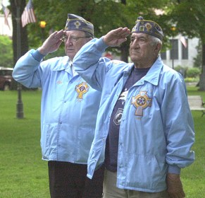 Bob Stauffer, left, and Manny Matos of the Catholic War Veterans Post 708 salute the flag during the playing of the National Anthem. ELIO GUGLIOTTI