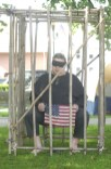 Joe Rannazzisi spends an hour locked up Saturday morning on the Naugatuck Town Green as part of a POW/MIA vigil. ELIO GUGLIOTTI