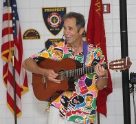 Les Julian sang songs in many different languages during his children's concert, We All Laugh in the Same Language, July 7 at the Prospect Fire House. The concert was hosted by the Prospect Public Library.