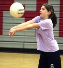 Olivia Kalentek, 12, bumps the ball during volleyball camp at Naugatuck High School July 14.